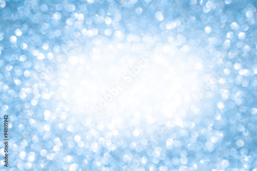 Blue bokeh christmas winter background with copy space