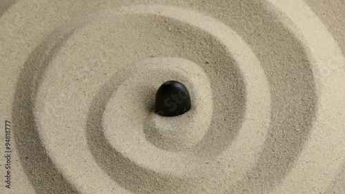Approximation of black  stone on the sand © alekleks