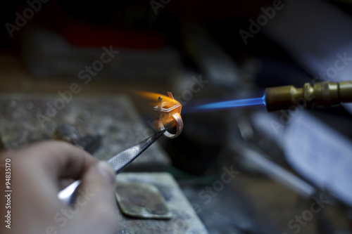 ewelry making close-up details of the production © homonstock