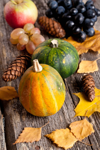 ... : seasonal pumpkin, apple and grapes with autumn leaves, closeup
