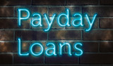 "Blue neon sign on a brick wall ""payday loans"""