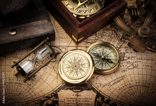 Old compass, astrolabe on vintage map. Retro stale. Poster