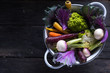 Fresh vegetables in rustic colander