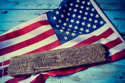 Poster text we do not forget you and the flag of the US