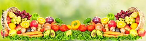 fototapeta na ścianę Fruits and vegetables over green background.