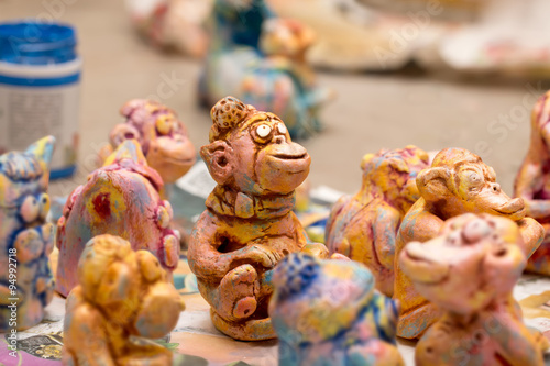 Poster Painted Colorful Handmade Clay figurines of monkeys