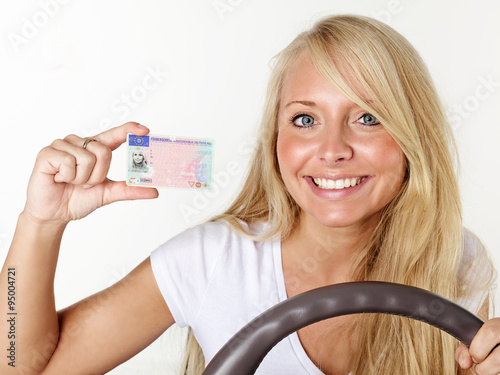 Woman shows her driver licence Poster