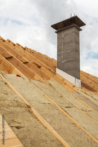 Roof under construction installation mineral wool for Mineral wool installation