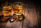 Fototapety Two glasses of whiskey with ice on wooden table