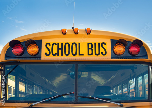 Front view of a yellow school bus Poster