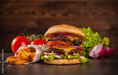 Fototapeta Delicious hamburger on wood