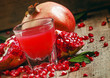 Freshly squeezed pomegranate juice, selective focus