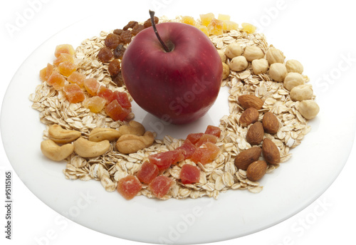 """oatmeal on a round plate with dried fruit, nuts and apple"""" Stock ..."""