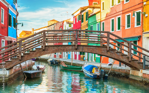 obraz PCV Small wooden bridge over a canal in Burano, Italy.