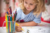 Fototapety Portrait of child girl drawing with colorful pencils