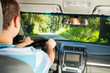 Driving man inside car with beautiful forest view