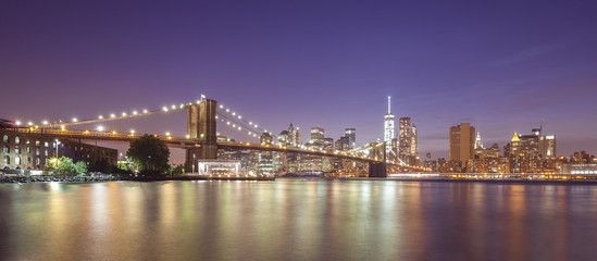 Hudson river and Manhattan waterfront at night, NYC, USA.