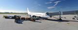 Fototapety Passagierflugzeug am Flugsteig eines Flughafens  - Beladung mit Gepäck und tanken von Kerosin // Passenger plane in the airport