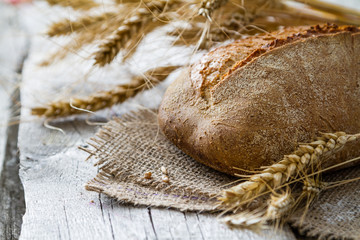 Bread, rye, wheat, rustic wood background
