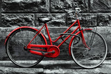 Fototapety Retro vintage red bike on black and white wall.