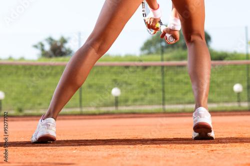 Obraz na plátně Legs of female tennis player.Close up image.