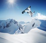 Snowboarder at jump inhigh mountains - 95278568