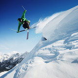 Skier in mountains, prepared piste and sunny day - 95278575
