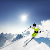 Skier in mountains, prepared piste and sunny day - 95278593