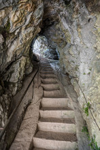 Stone Staircase in a Corridor in the Cave. Passage through the Rock.