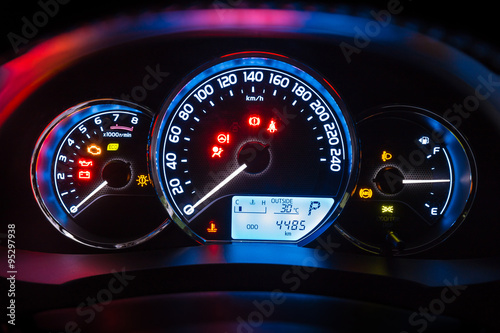 Modern car instrument dashboard panel  in night time Poster