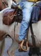 Obrazy na płótnie, fototapety, zdjęcia, fotoobrazy drukowane : Cowboy foot in the stirrup of the horse