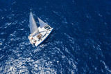 Amazing view to Catamaran cruising in open sea at windy day. Drone view - birds eye angle - 95331721