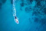 amazing view to yacht, swimming woman and clear water caribbean paradise - 95331747