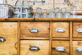 Pine wood sideboard in a dining room. Scandinavian antique. Close up detail.