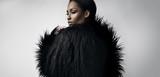 Fototapety black woman wears black faix fur jacket