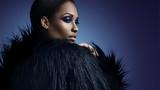 gorgeous black woman in faux fur jacket