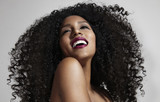 laughing woman with afro hair