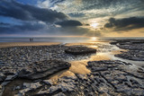 Stunning vibrant sunset landscape over Dunraven Bay in Wales