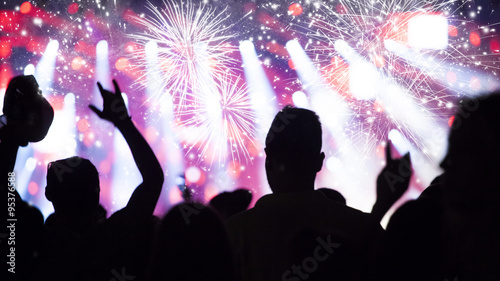 Naklejka New Year concept - cheering crowd and fireworks