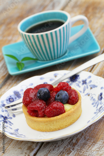Photo: Crunchy tartelette with fresh fruit and cup of coffee on rustic ...