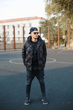 Young handsome guy in black clothes and winter jackets - 95395951