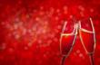 Obrazy na płótnie, fototapety, zdjęcia, fotoobrazy drukowane : Two champagne glasses over red christmas background