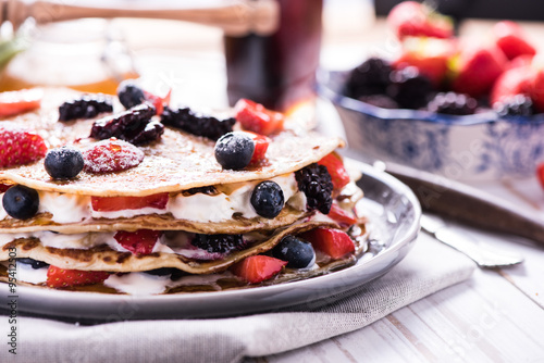 Foto op Canvas Chocolade Homemade pancakes with berry fruits