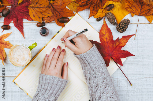 Beautifully manicured woman nail writing some notes. © tamara83