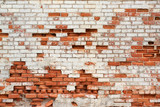 Fototapety Aged crumbling street wall background with red bricks texture