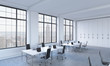 Workplaces in a bright modern open space loft office. White tables equipped with modern laptops and black chairs. New York panoramic view in the windows. 3D rendering.