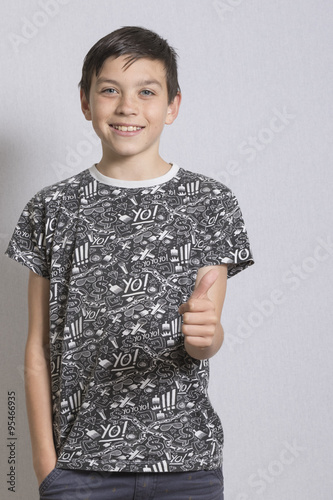 Poster Portrait of Young Boy With Thumbs Up Gesture
