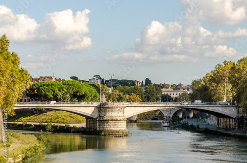 Keuken foto achterwand Schip Quay of the river Tiber in Rome, Italy and the bridge across it, floating on the river excursion boat for tourists