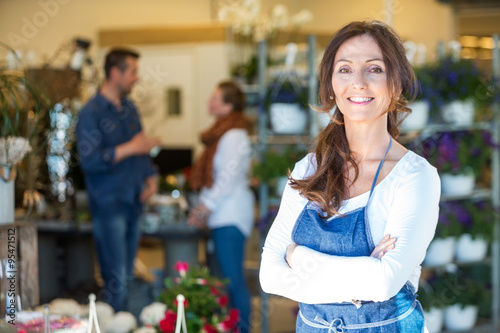Portrait Of Smiling Florist At Flower Shop