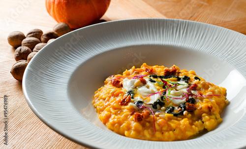 "Pumpkin risotto with sun-dried tomatoes and mozzarella"" Stock photo ..."